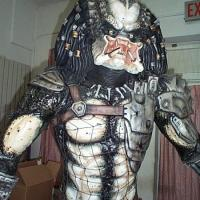 here is the 1/1 predator...its not a full figure. the back is flat so i can be placed against a wall...but its still pretty cool. the factory paint job sucked big ass...so i repainted him.  Here he is almost done!